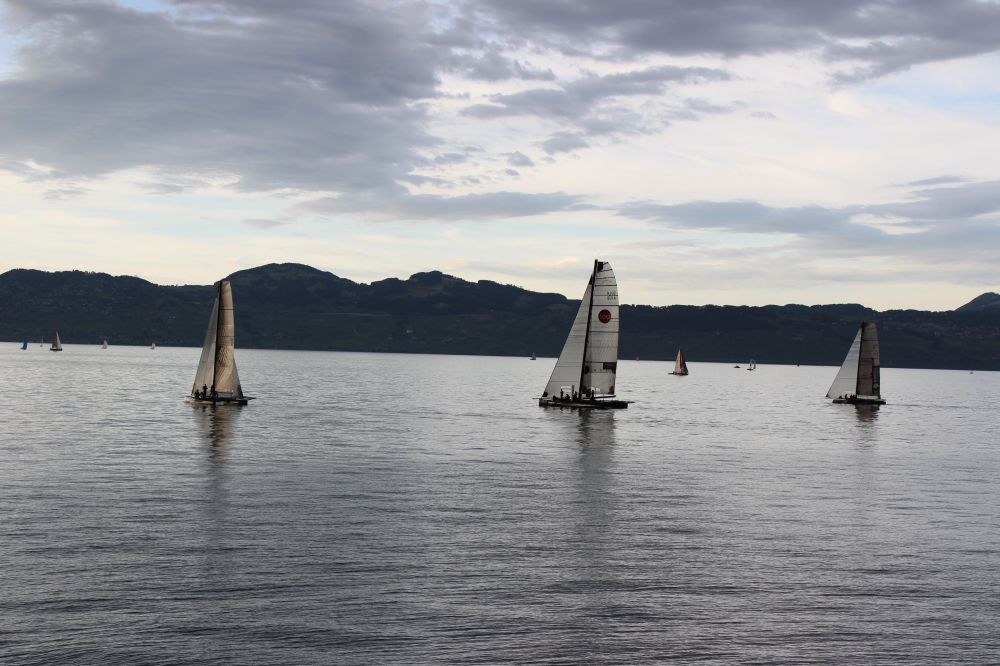 Bol d'Oro regatta Lake Geneva Leman some going other coming bacl=k